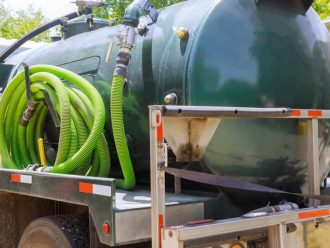 septic pumping truck emptying tank in Tuscaloosa